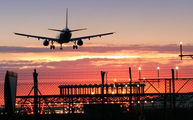 airplane-landing-sunset_645x400.jpg